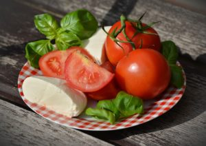 Mozzarella, tomatoes, and basil on a plate